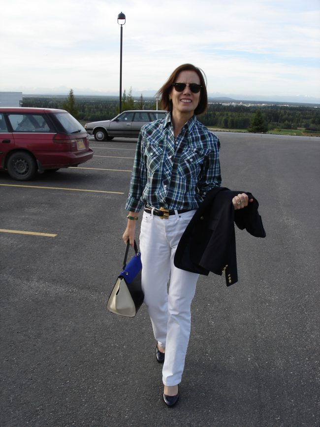 midlife blogger in white boyfriend jeans with navy blazer, plaid shirt, and pumps in September