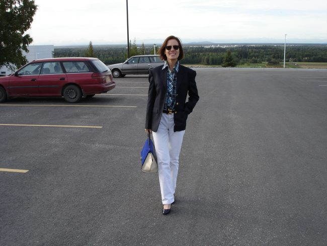 fashion blogger in business casual work outfit with white pants in fall