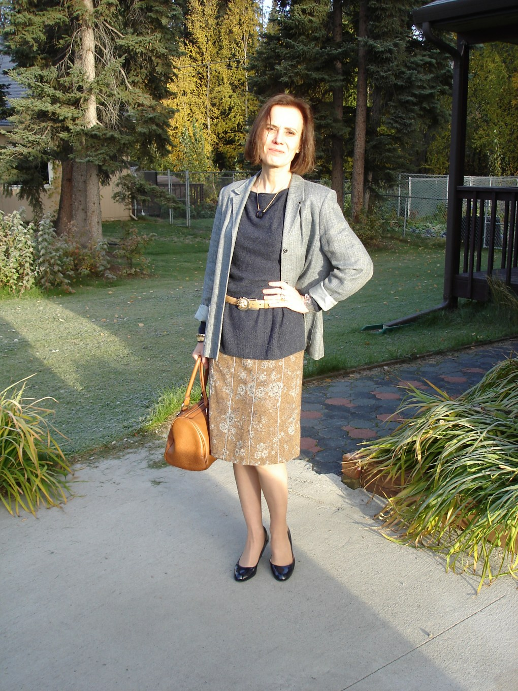 over 50 old woman in tweed skirt with blazer as unmatched suit