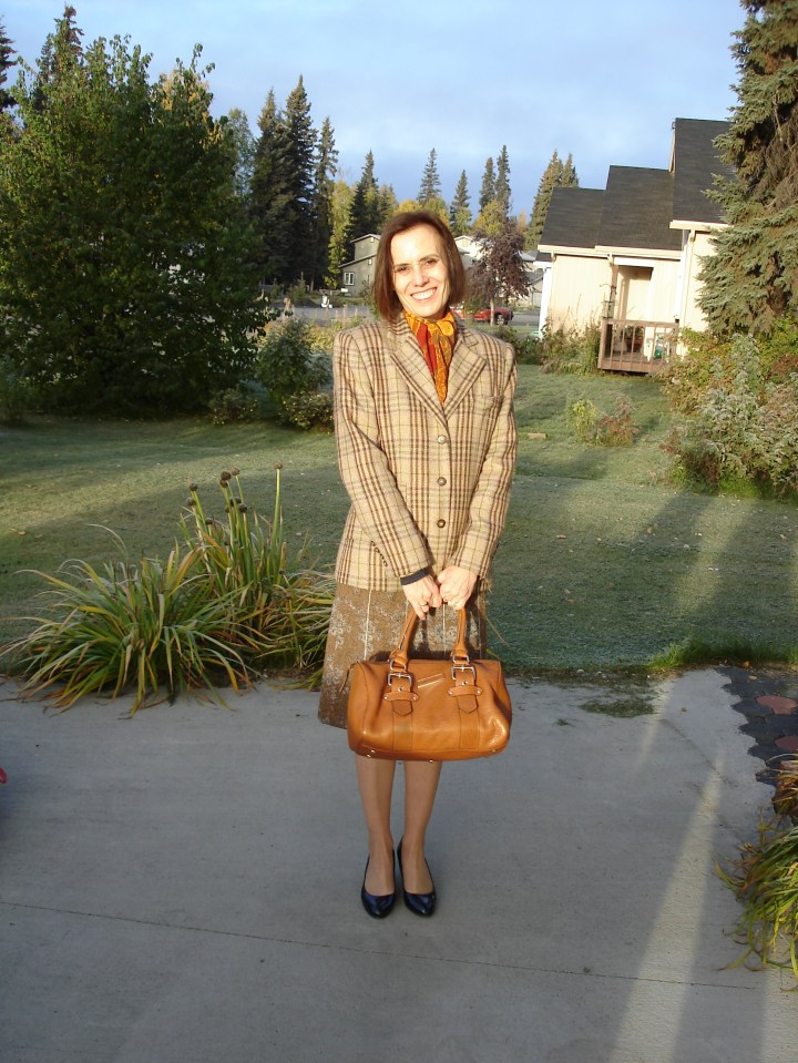 #styleover50 mature woman wearing a tweed skirt styled with outerwear