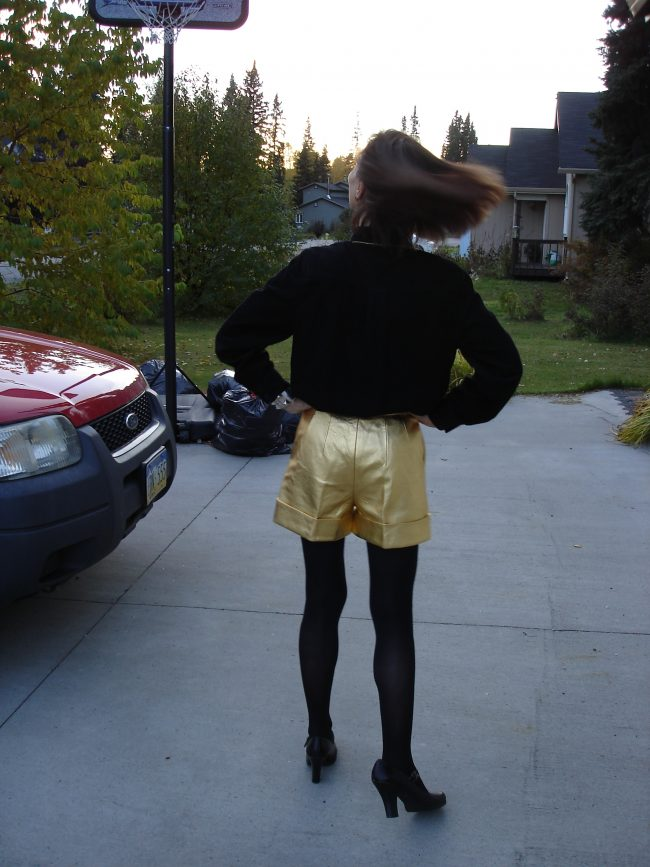style book author in golden shorts