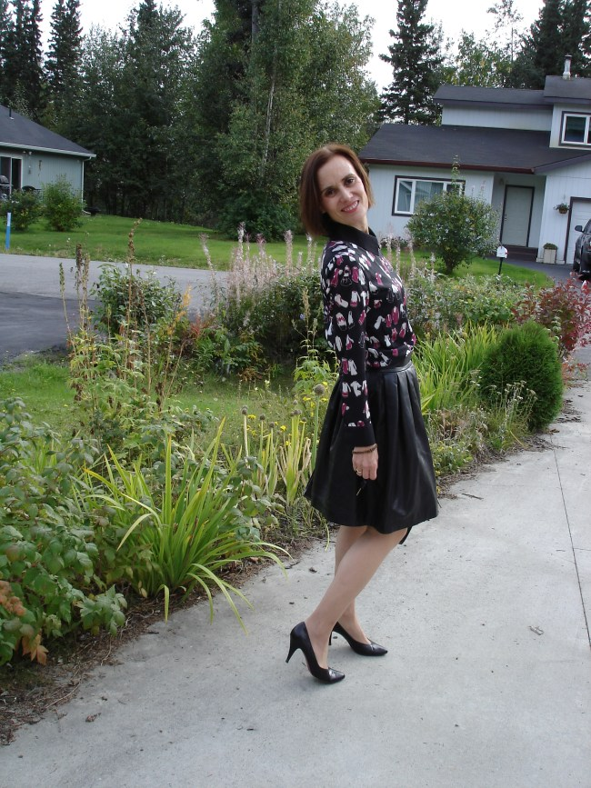 #styleover40 midlife woman wearing a Victoria Beckham dress under leather skirt
