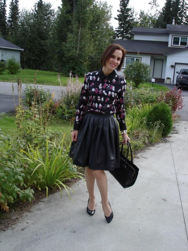 #fashionover40 mature woman wearing a Victoria Beckham dress under a skirt
