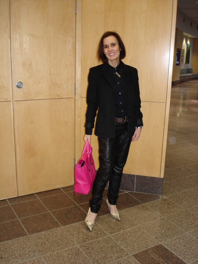 mature woman in work outfit with leather pants