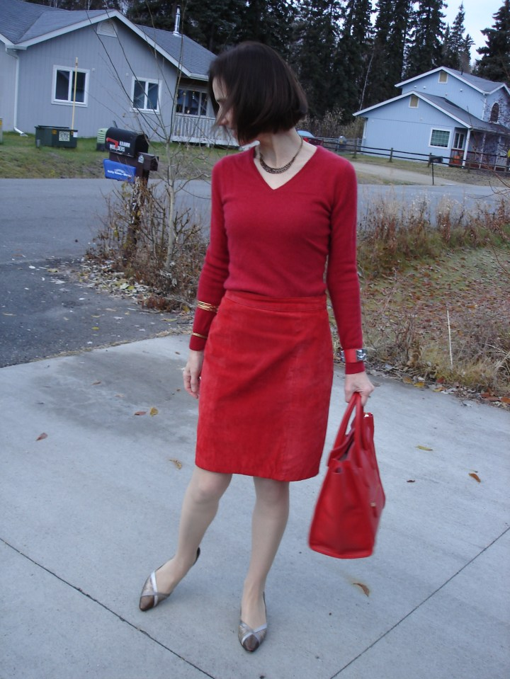 woman looking chic in a suede straight skirt