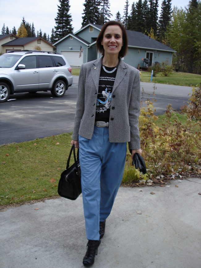 Alaska street style blogger in houndstooth blazer, college T-shirt, leather pants