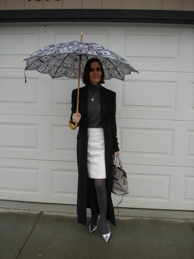 stylist matching the umbrella to the outfit to up the mood on a rainy day