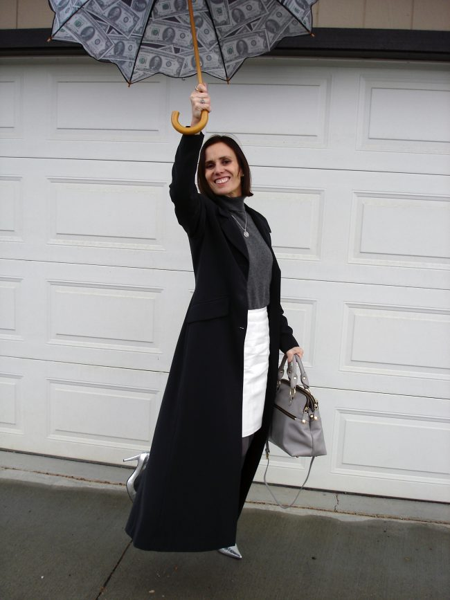 style blogger pretending to fly with an umbrella like Mary Poppins