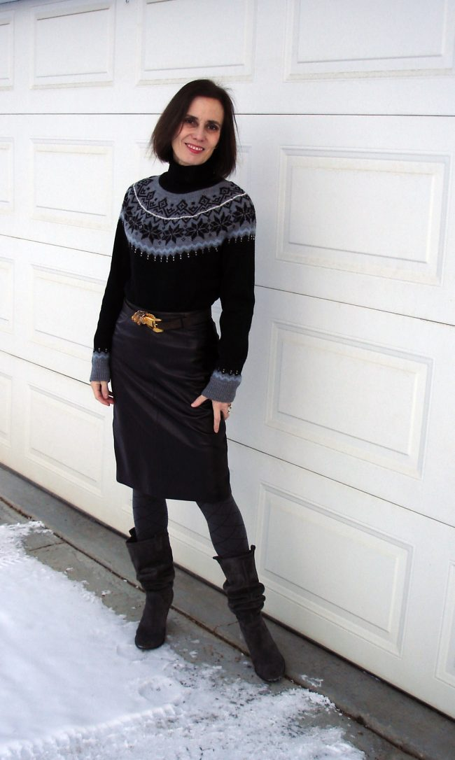 style book author wearing a traditional Fair Isle sweater with a leather pencil skirt