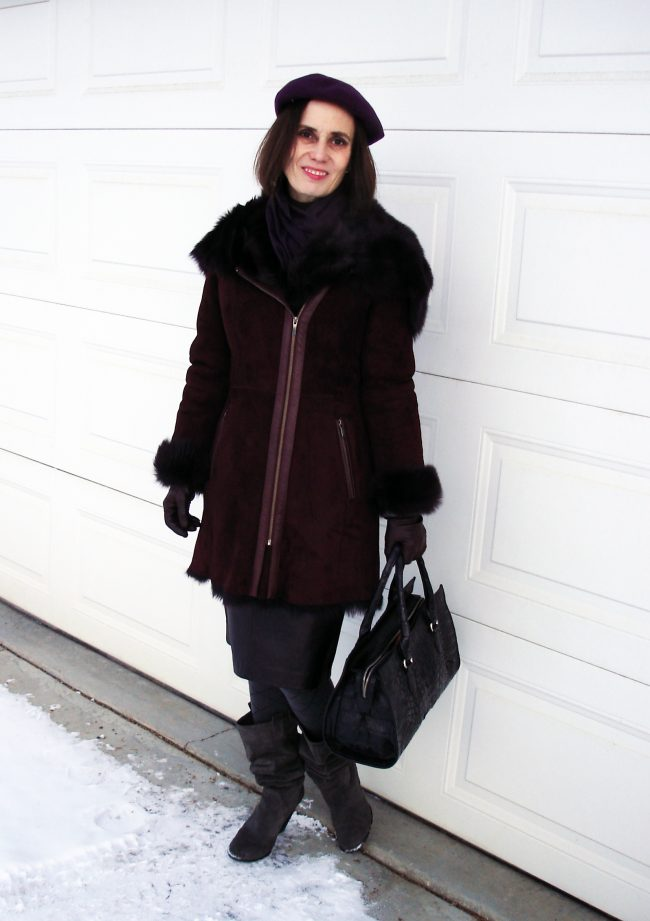 stylist in eggplant shearling coat and beret