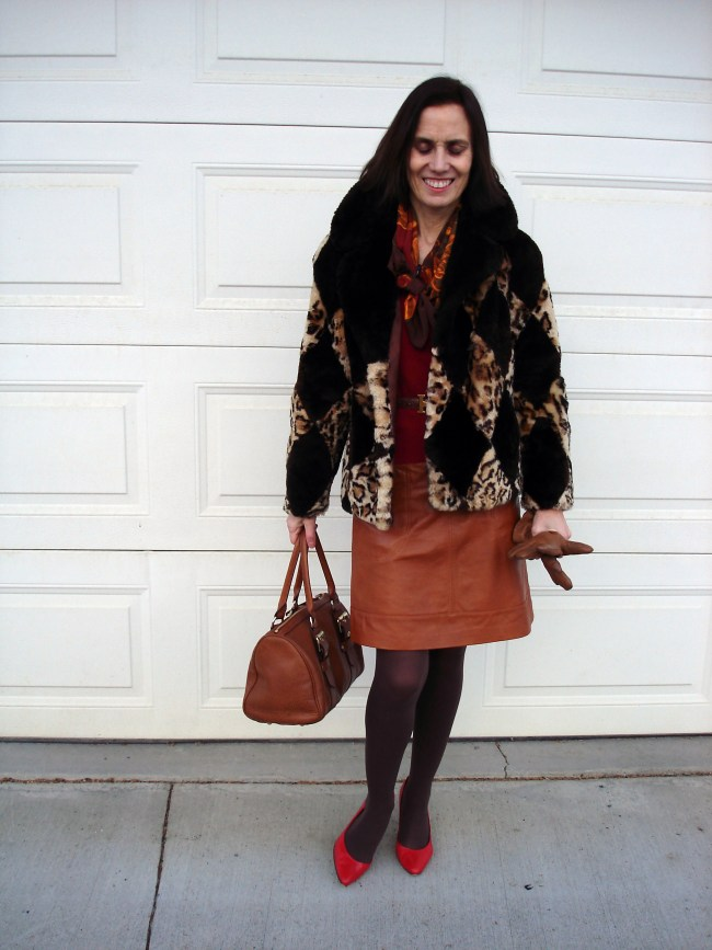 over 50 years old style blogger with diamond leopard print jacket and tan leather skirt