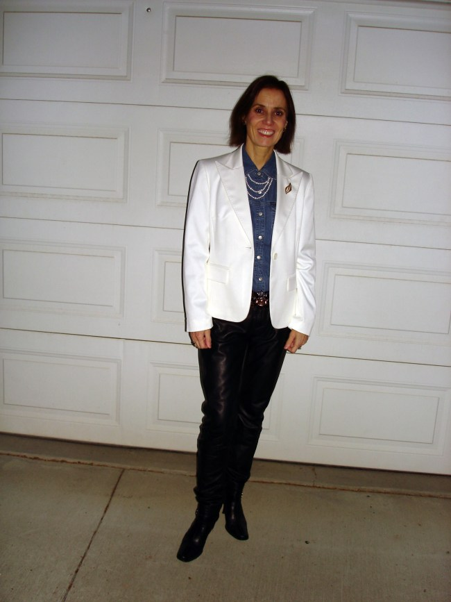 over 50 years old fashion blogger in black leather pants, denim and white blazer outfit for work in winter