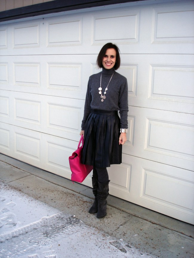 #advancedfashion over50 year old woman in a winter outfit with a pleated leather skirt