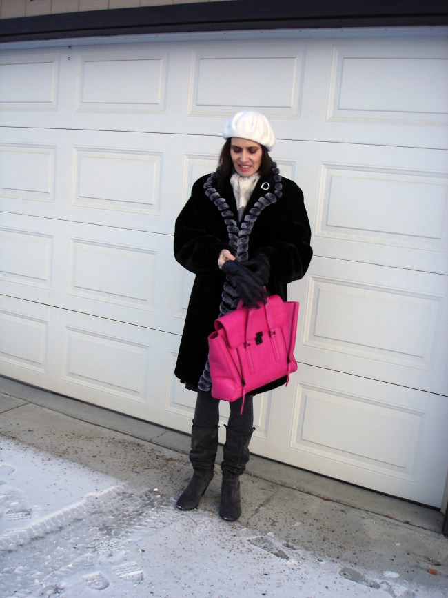#styleover50 mature lady with a faux fur A-line coat and leather glove and skirt