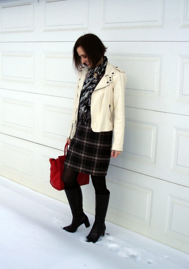 over 50 years old fashion blogger ind plaid sheath leopard rint scarf, tall heeled boots, white motorcycle jacket