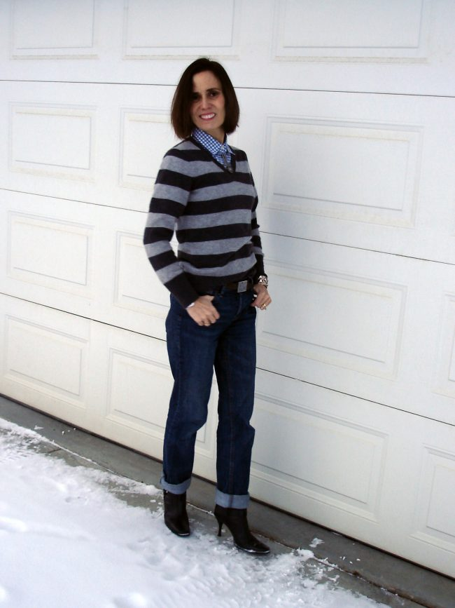 influencer in old blue jeans sweater over shirt
