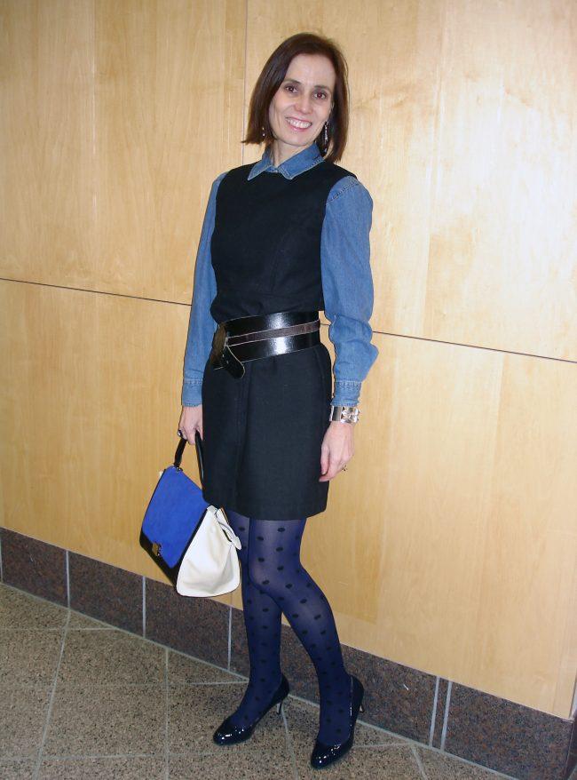 woman wearing a denim shirt under a dress