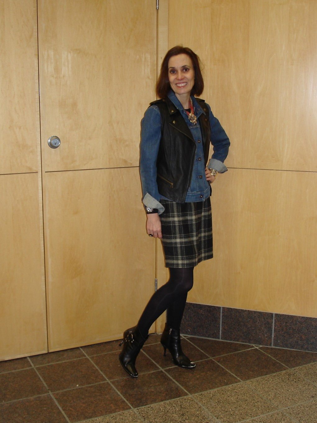 #fashionover40 woman in a plaid dress with denim jacket