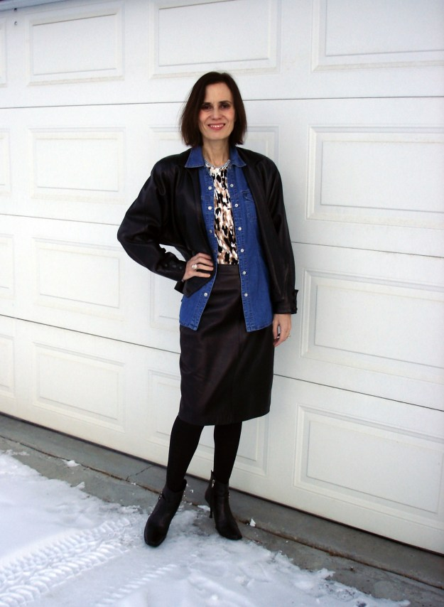 over 50 years old fashion bloger wearing leather-on-leather with a skirt and jacket