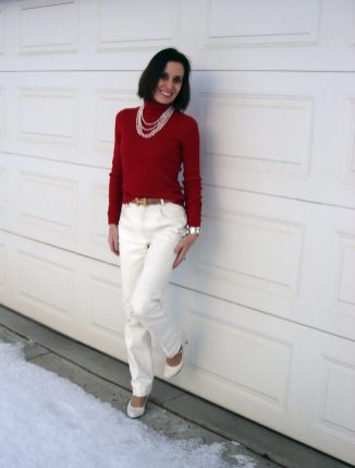 Fairbanks woman in white leather pants with red turtle neck top