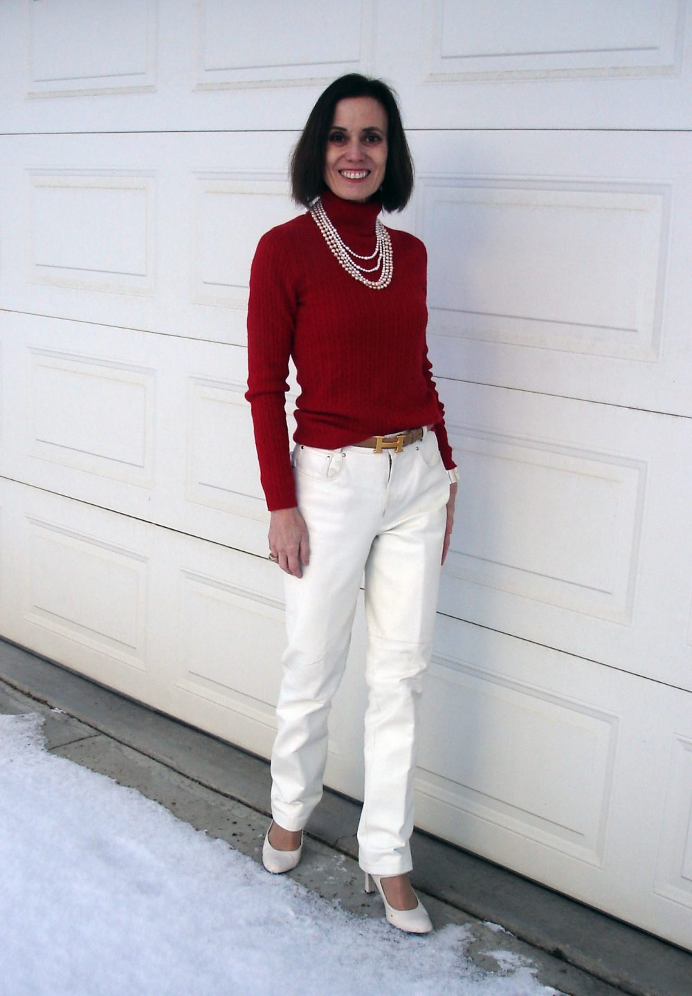 fashion blogger in red top white leather pants holiday outfit