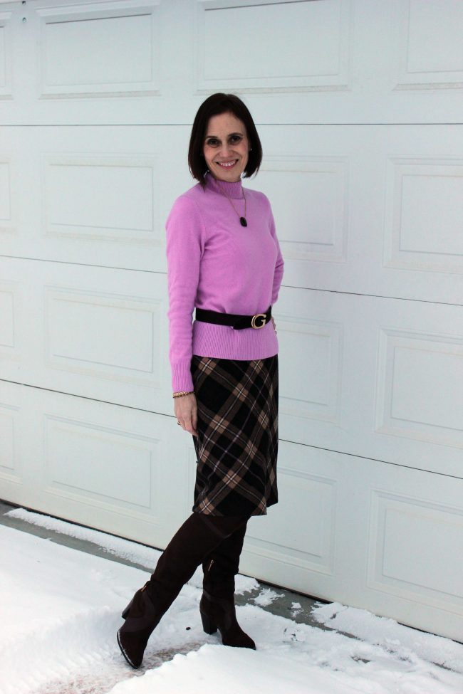 stylist in pink sweater, brown tigh high boots, brown midi skirt