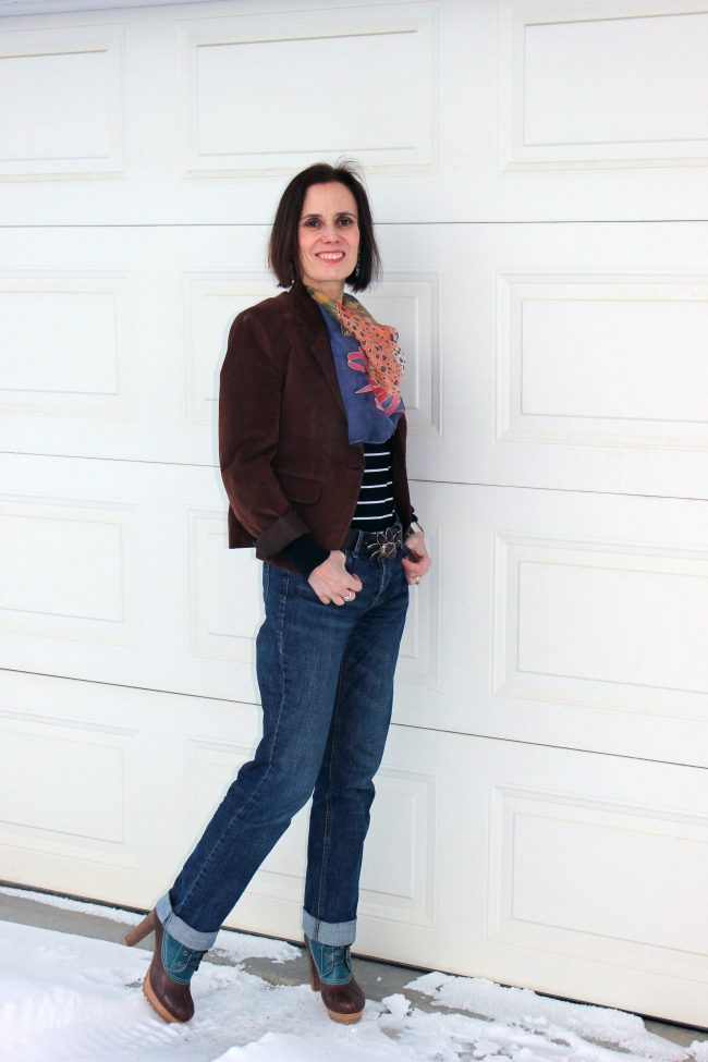 midlife style blogger in jeans, blazer, sweater, scarf and heeled ducks