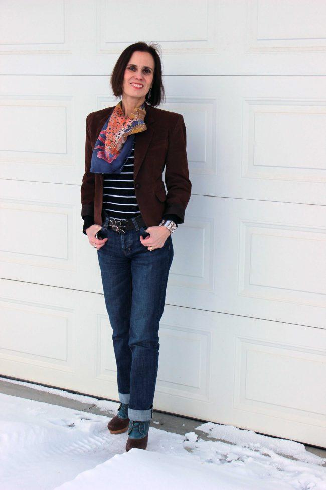 stylist in jeans, faux suede blazer, striped top, scarf
