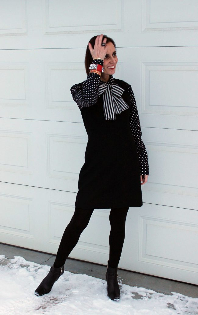 stylist in jumper with polka dot blouse, stripped scarf