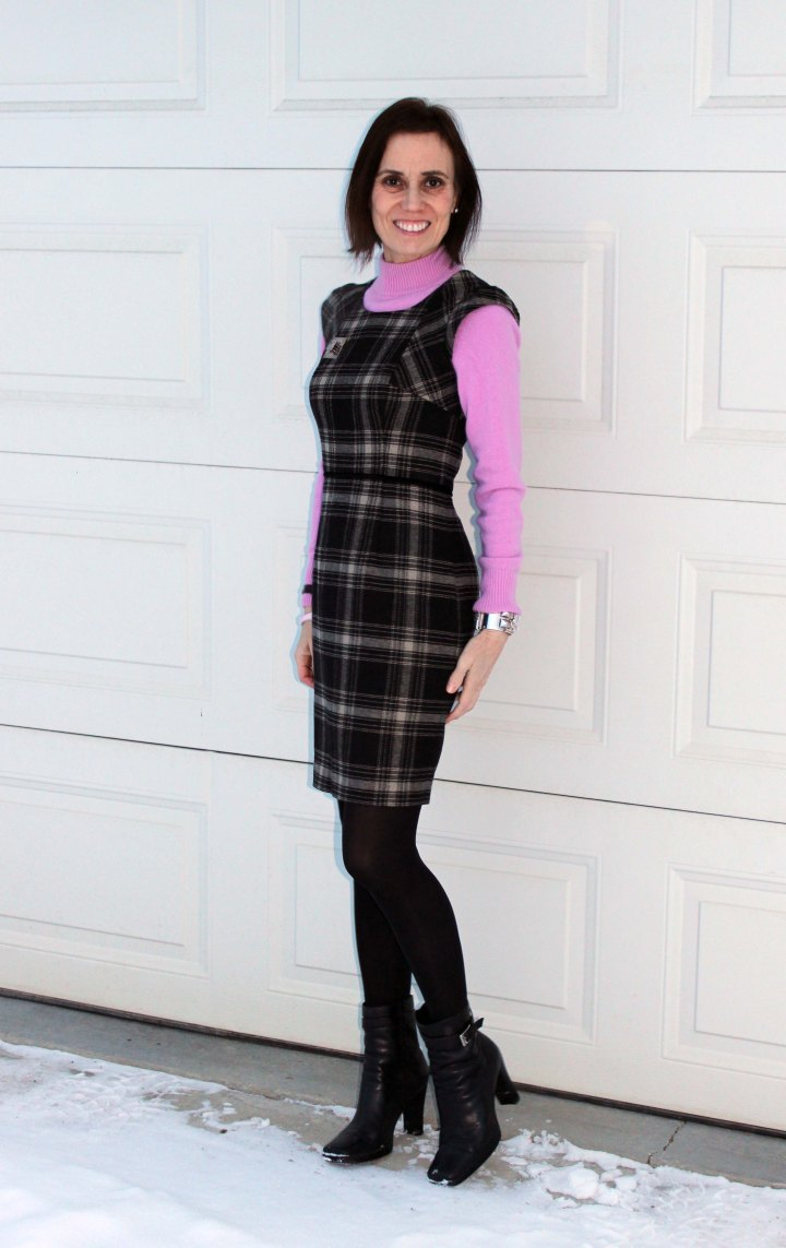 #fashionover40 woman in mock neck cashmere knit sweater under a sheath dress