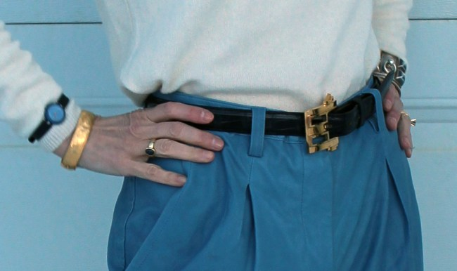 details of jewelry and statement belt