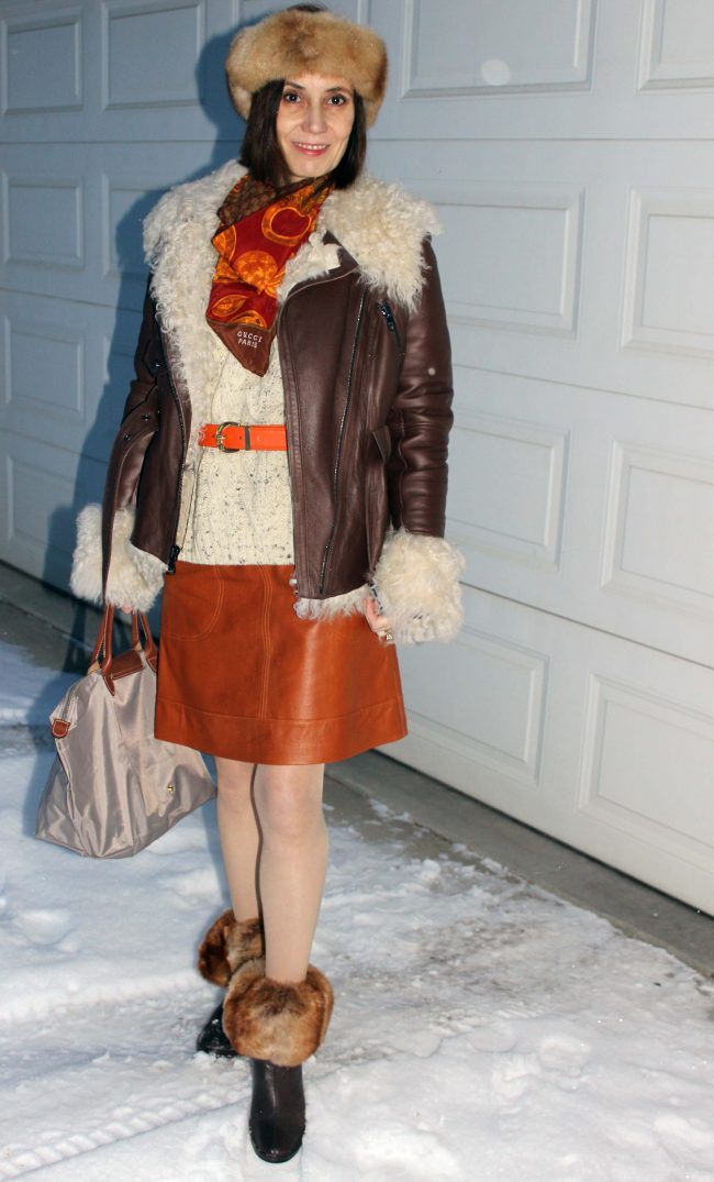 style book author in leather skirt pantyhose, motorcycle shearling headband