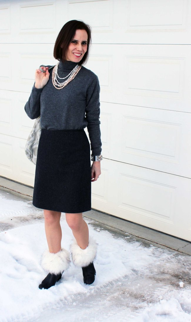 Mature fashion blogger showing how to wear boot toppers with ankle boots