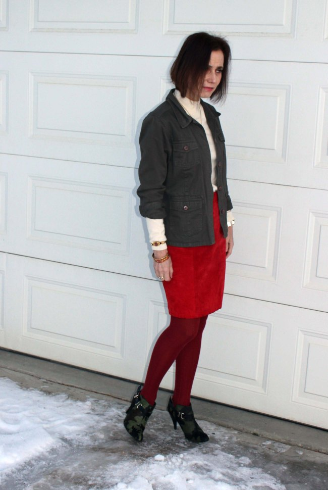 #fashionover50blog over 50 years old fashion blogger wearing red and camo with an army green jacket