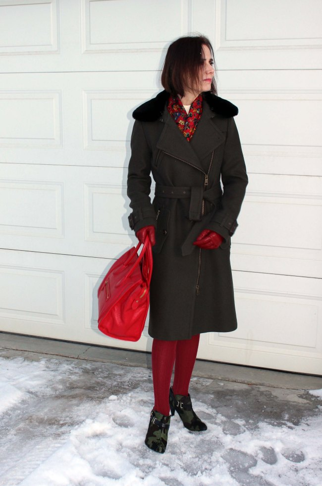 styler blogger in loden motorcycle coat, red tights, gloves and bag with floral scarf