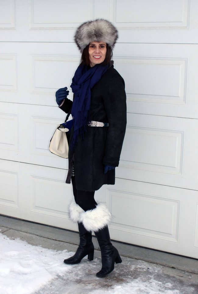midlife woman wearing a shearling coat and boot toppers