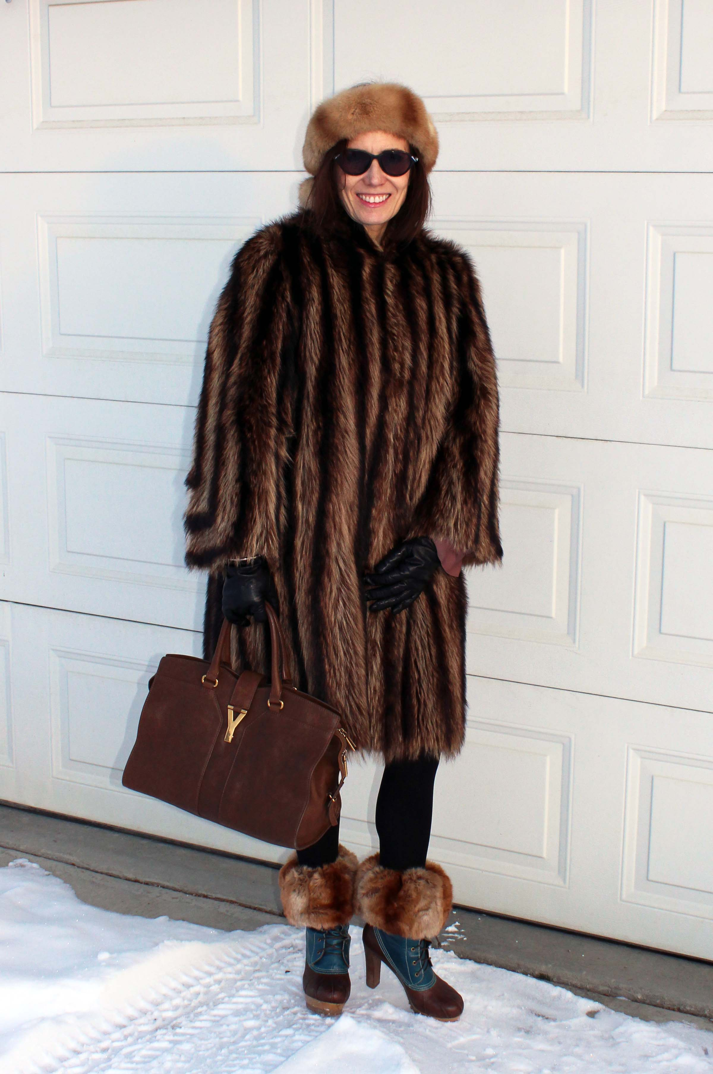 style blogger in heeled duck boots with toppers, fur coat and head band