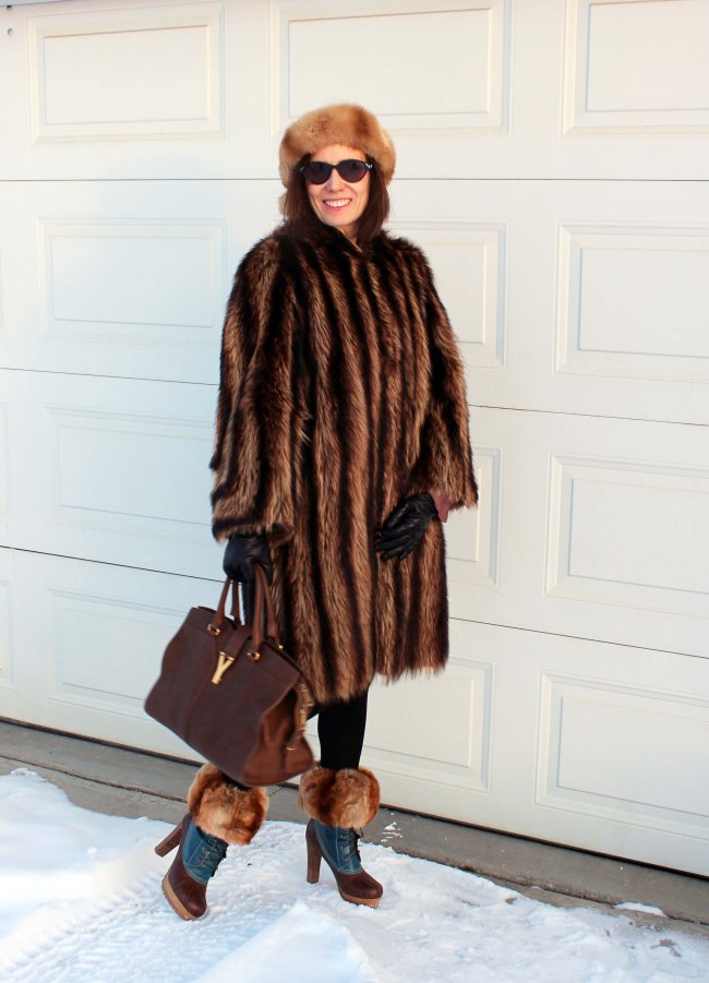 Style blogger in winter outerwear with hat and boot toppers