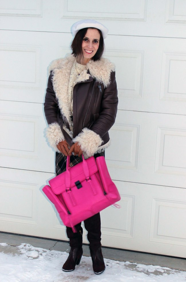 Mature blogger in shearling motorcycle jacket