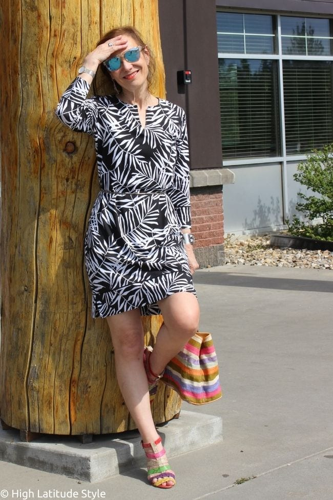style book author in black and white tropical leaves print dress with mirror eyewear