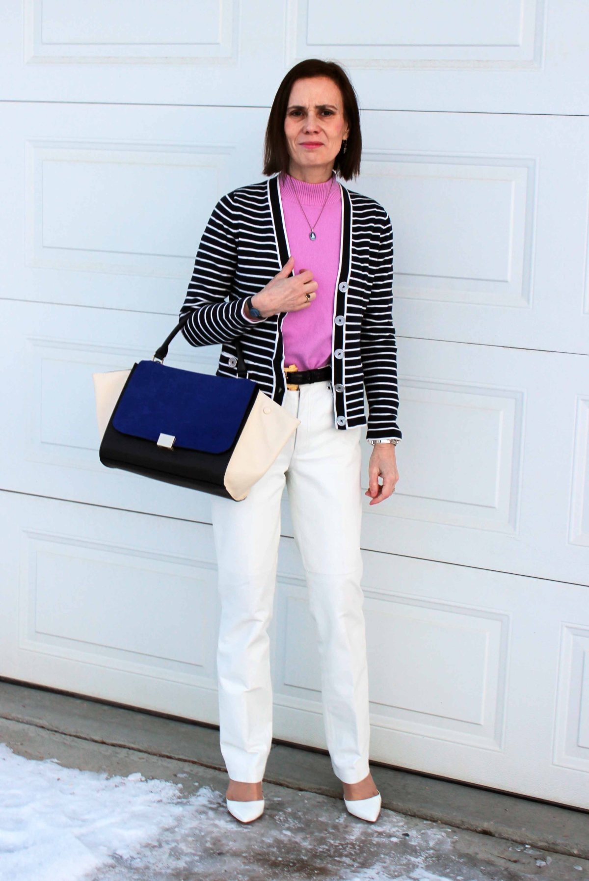 older woman in blue white and pink office outfit