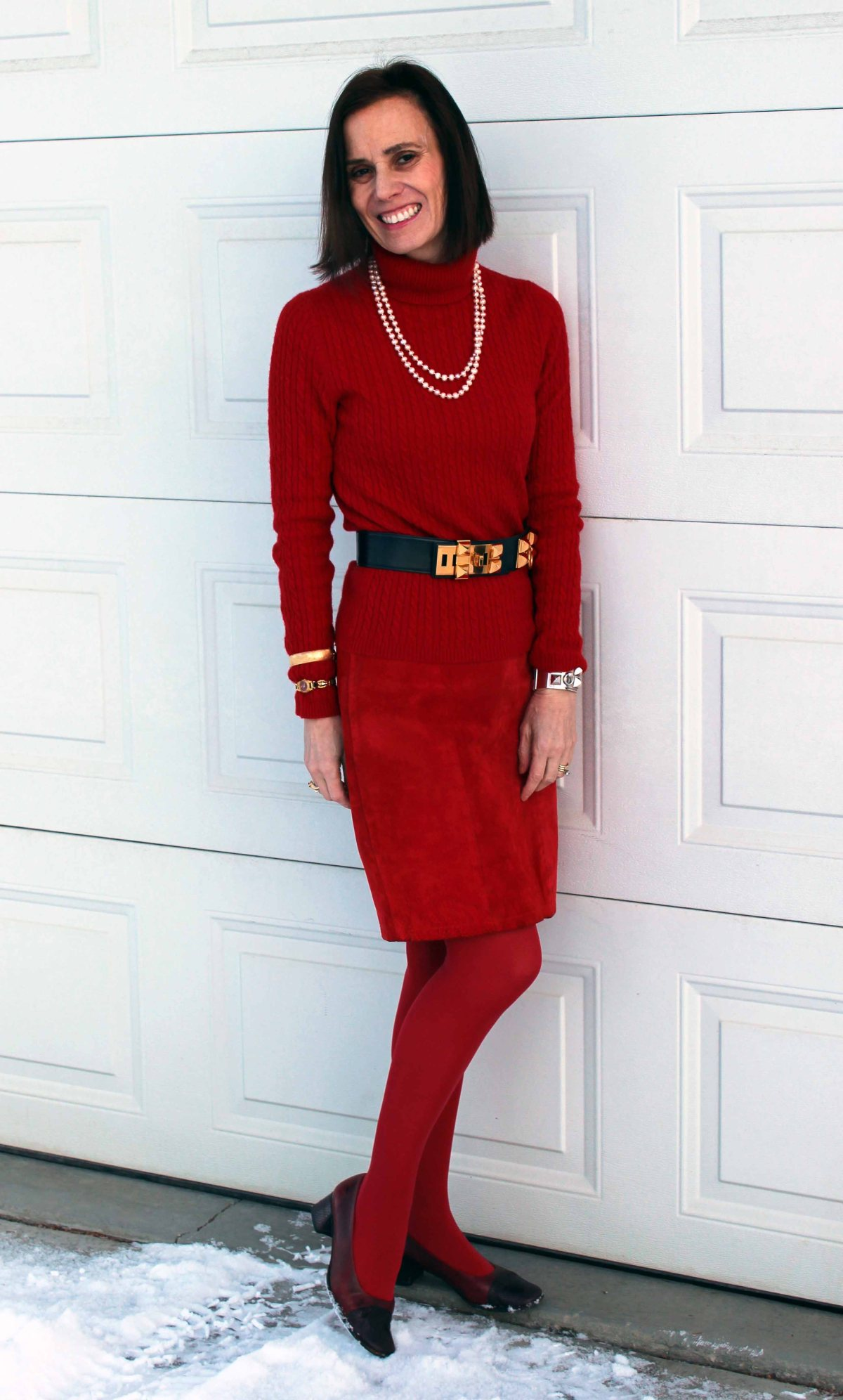 over 40 year old wearing a red leather skirt