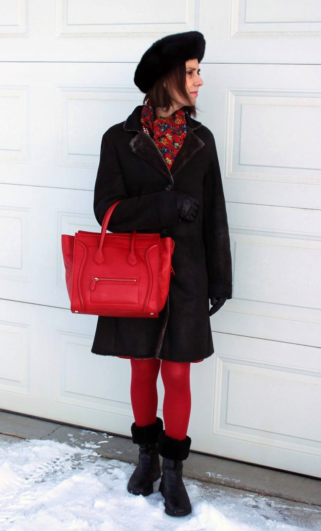 stylist pairing a monochromatic red outfit with black outerwear