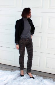 style blogger over 50 wearing camo pants with a black blazer