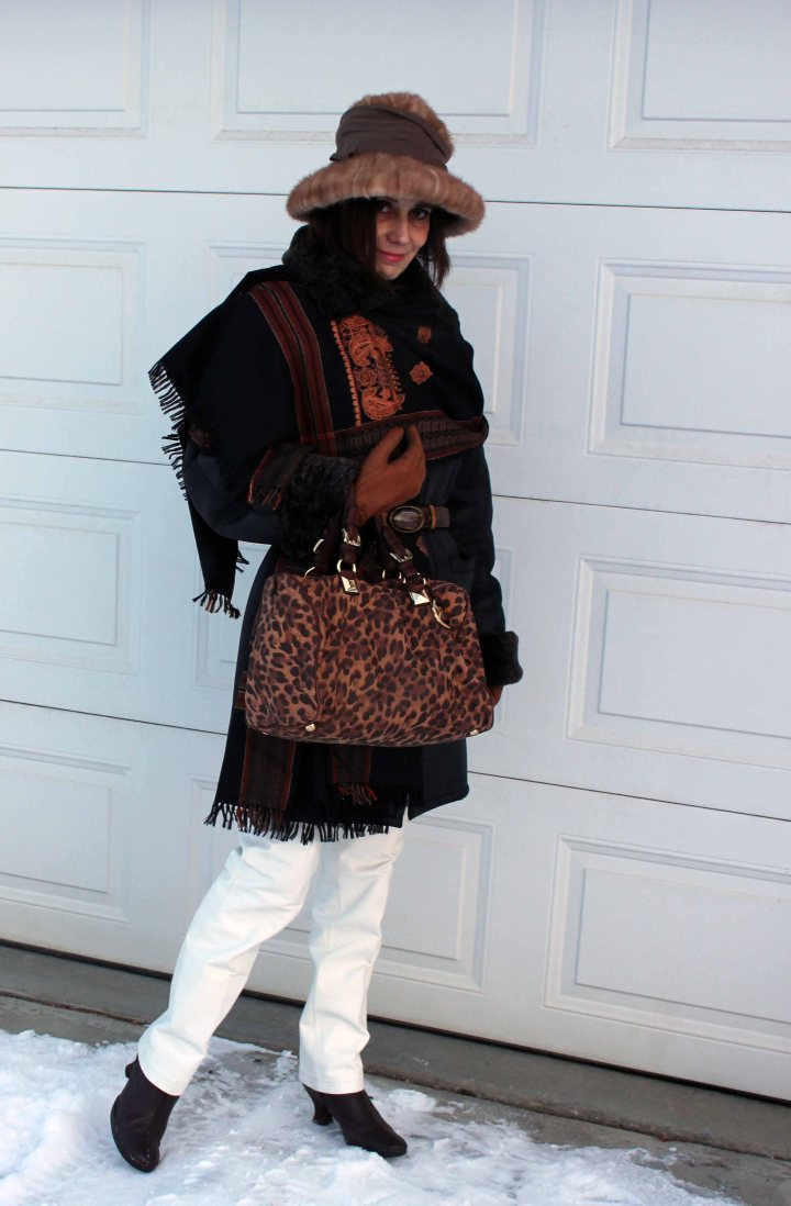 #advancedstyle mature woman in white leather pants, shearling coat, Indian ethnic scarf, loafers and hat