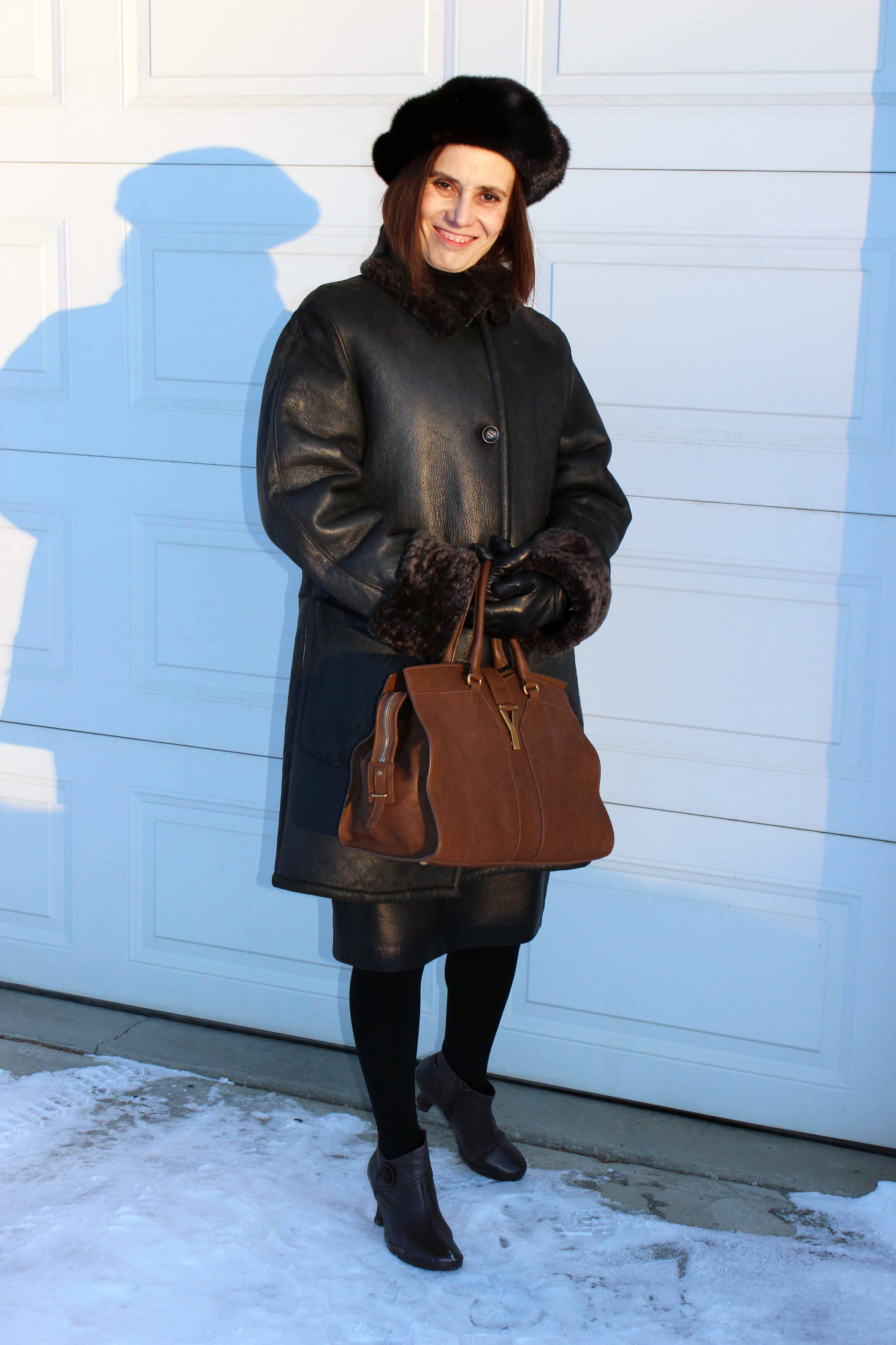 woman in shearling coat and hat