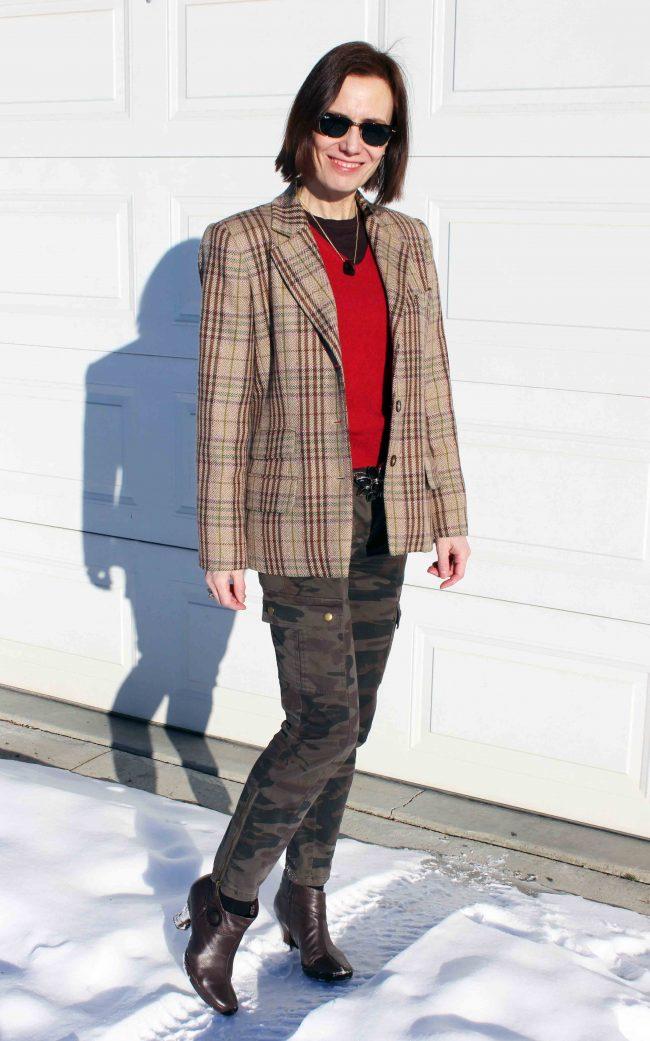 influencer in a plaid blazer, red sweater camo cargos