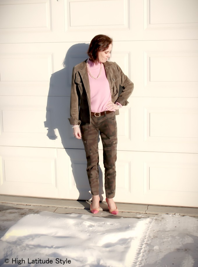 midlife woman in posh street chic in pink with camo cargoes