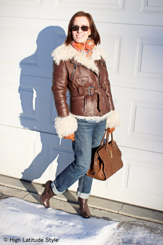 Alaskan fashion blogger in shearling motorcycle jacket, multi color scarf jeans