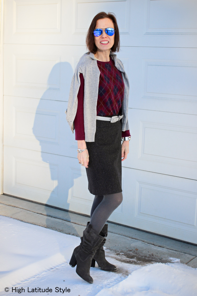 style book author in winter look with tweet skirt with sweater and cardigan worn over the shoulders